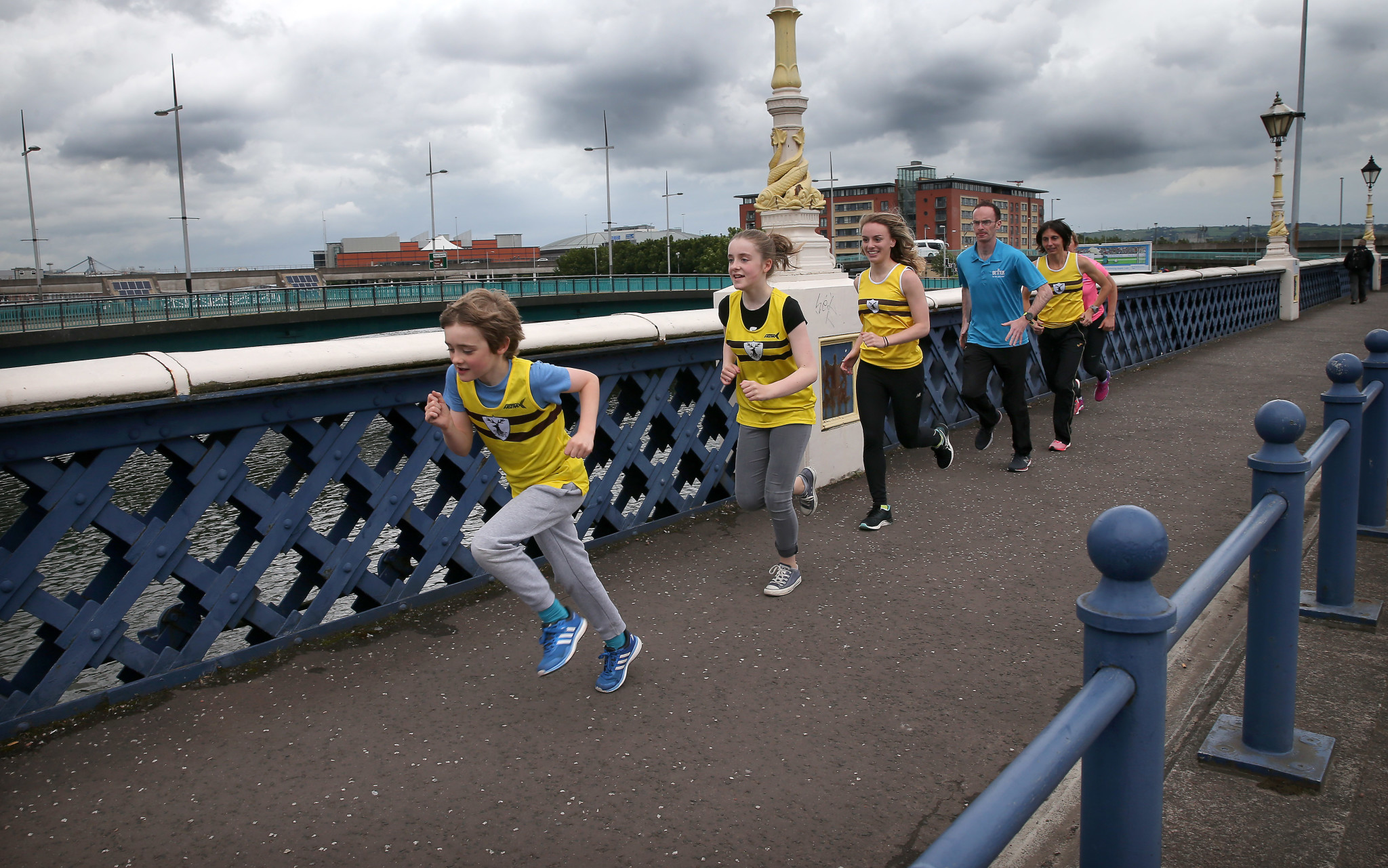 Laganside 10k launch photograph with Belfast Lord mayor Brian Kingston. Photograph taken at the Queens Bridge / Big Fish area of the Laganside. 30th June 2016 Photograph By Declan Roughan (L-R) Finn Harding, Erin Harding, Caitlin Maguire, Kent Swann, Gladys Ganiel and Jenny McCready.
